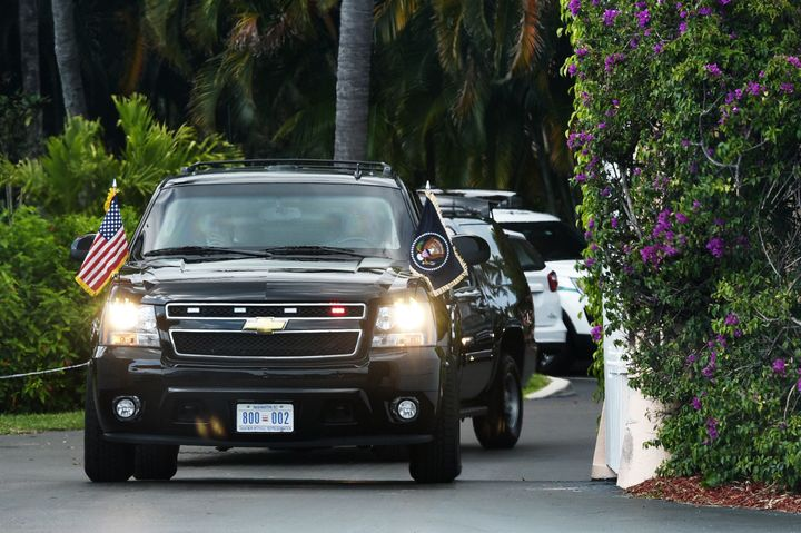 The motorcade carrying President Donald Trump pulls out of his Mar-a-Lago estate on March 19, 2017.