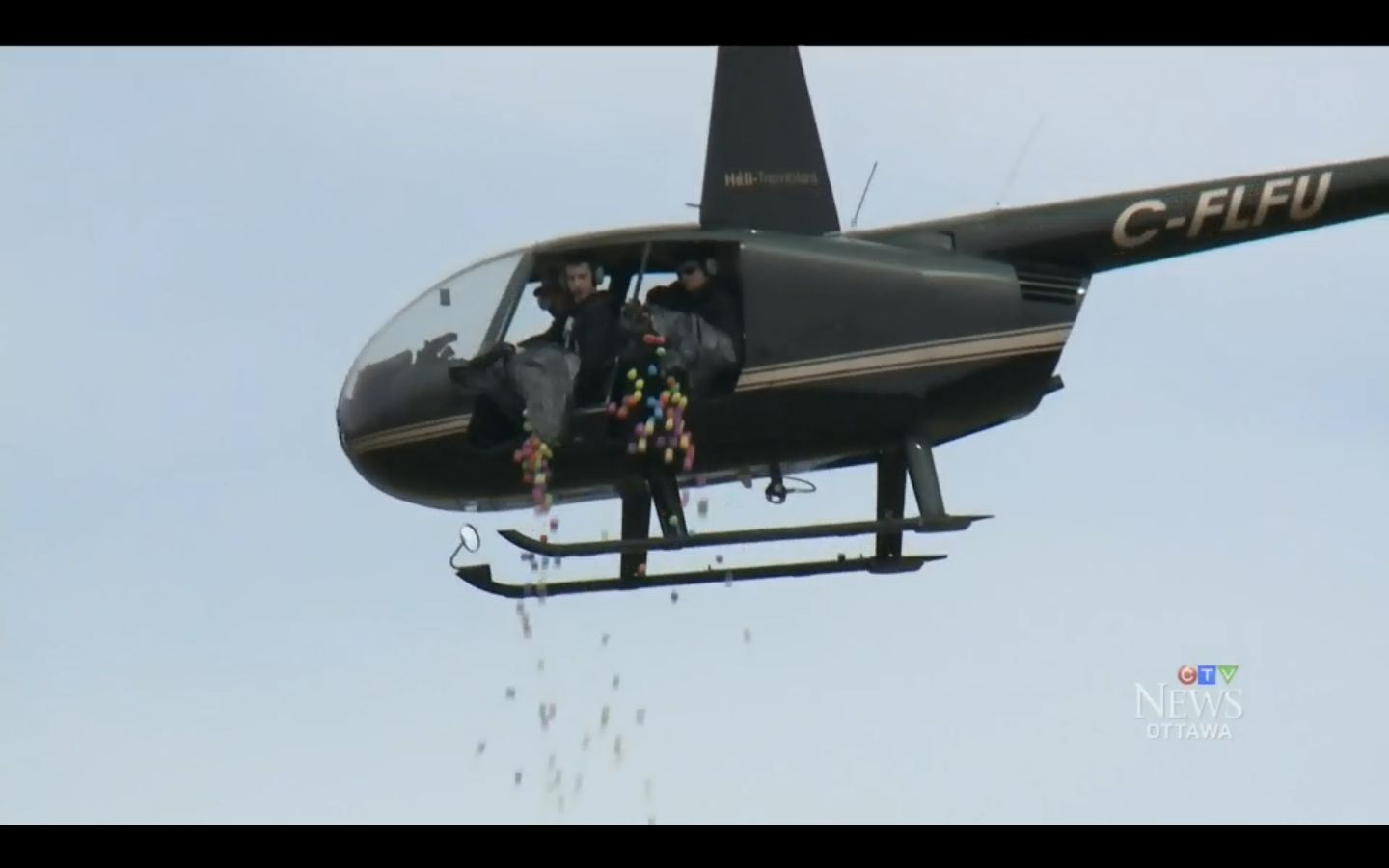 A helicopter is seen dumping bags full of Easter eggs during an Easter egg drop in Canada