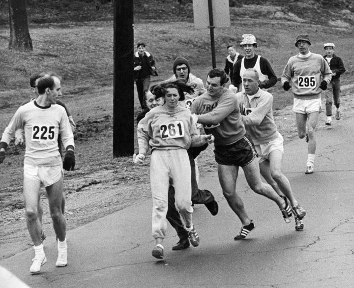 Kathrine Switzer of Syracuse, New York, was spotted early in the Boston Marathon by Jock Semple, center right. He tried to rip the number off her shirt and remove her from the race.