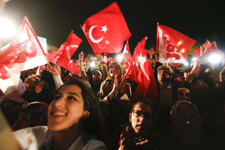 Supporters of Turkish President Tayyip Erdogan celebrate in Istanbul, Turkey, April 16, 2017.