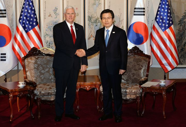 Vice President Mike Pence shakes hands with South Korean acting president and prime minister Hwang Kyo-ahn during their meeti