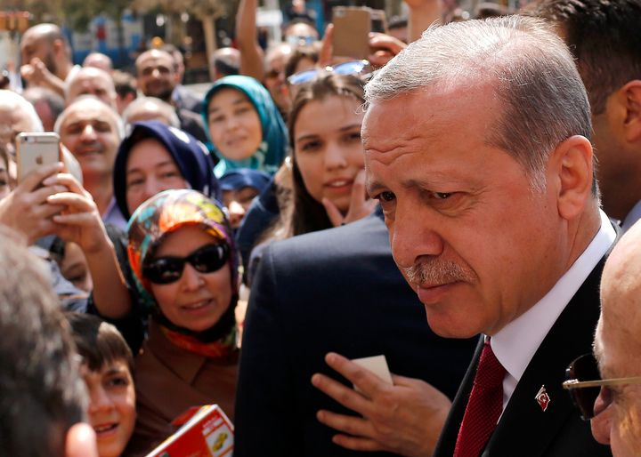 Turkish President Recep Tayyip Erdogan talks to supporters as he arrives at Eyup Sultan mosque in Istanbul, Turkey, April 17,
