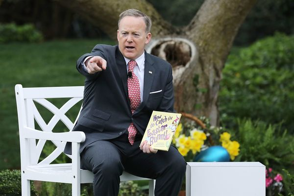 White House press secretary Sean Spicer reads the children's book <i>How to Catch the Easter Bunny</i> during the 139th Easte