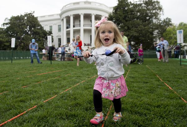 Daphne Rank, from Dillsburg, Pennsylvania, participates in an Easter egg roll race.