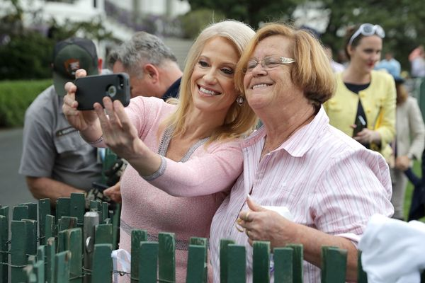 White House counselor to the president Kellyanne Conway poses for a selfie with a supporter.
