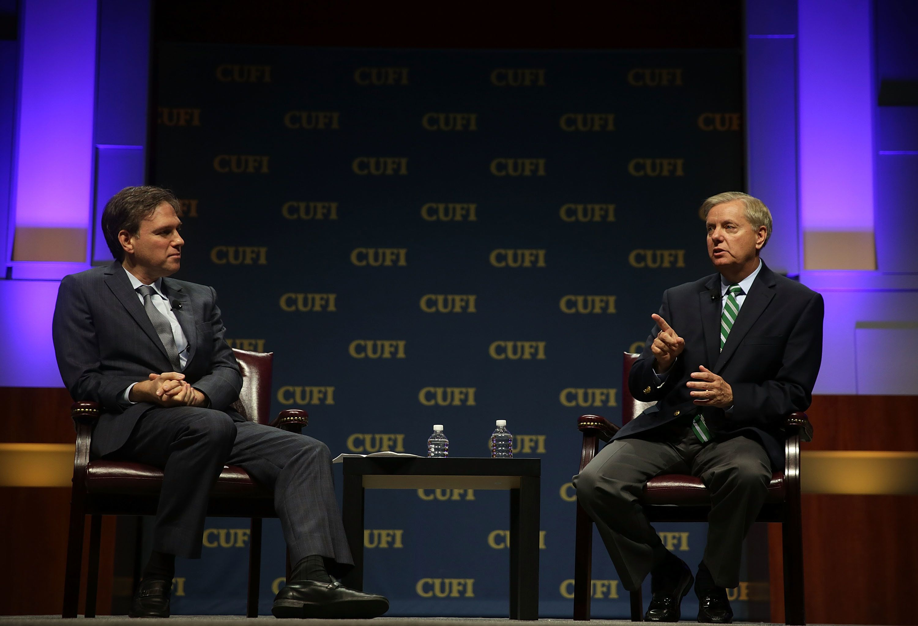 WASHINGTON, DC - JULY 13:  Republican U.S. presidential hopeful, Sen. Lindsey Graham (R-SC) (R) participates in a discussion with moderator Bret Stephens of the Wall Street Journal during a Christians United for Israel summit July 13, 2015 in Washington, DC. A number of Republican presidential hopefuls were invited to speak at Christian United for Israel's 10th annual Washington summit.  (Photo by Alex Wong/Getty Images)