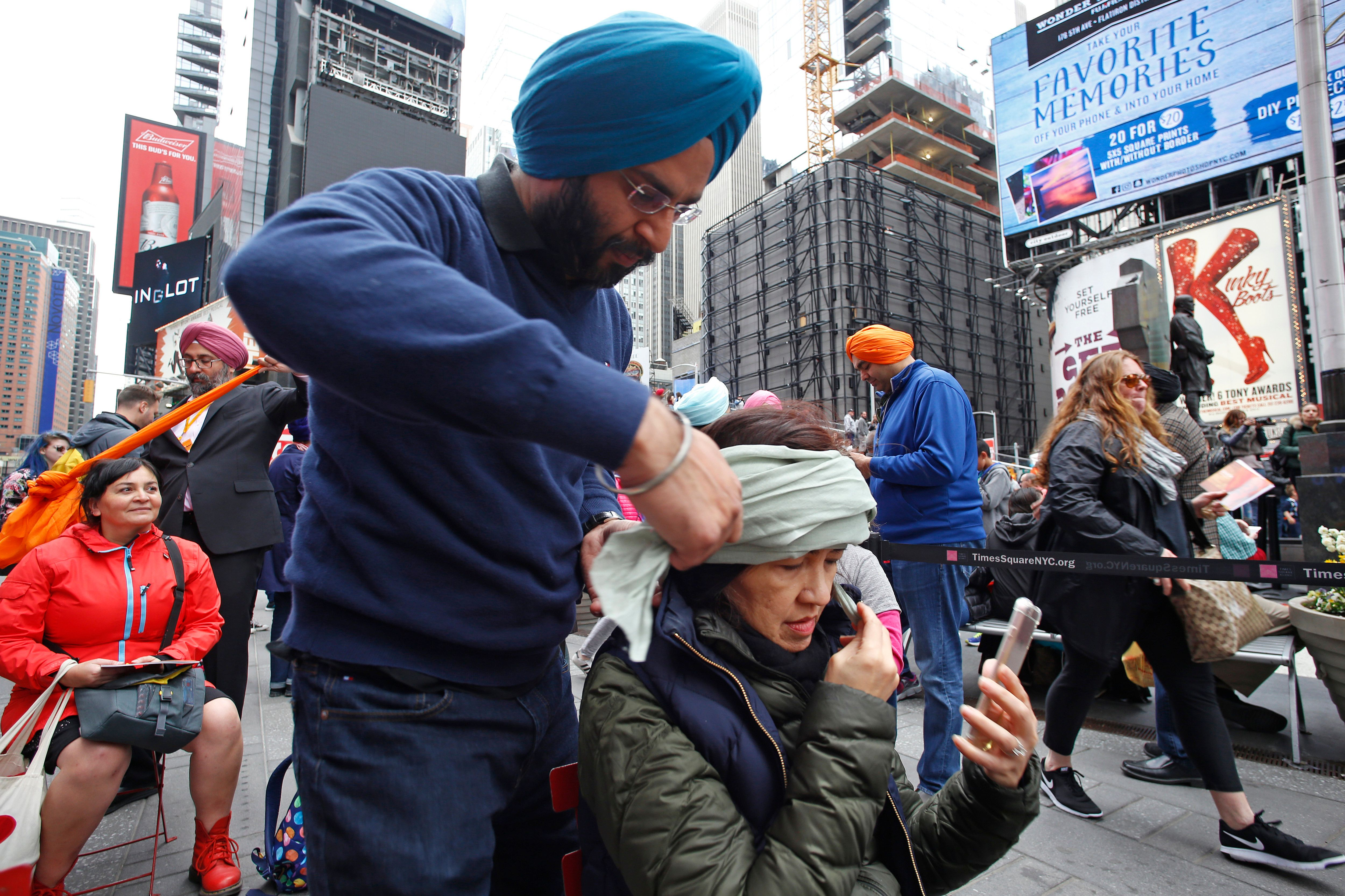 Sikhs of New York organizeda Turban Day in Times Square. Volunteers were on hand to help tie traditional Sikh turbans f