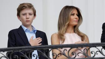U.S. President Donald Trump, U.S. first lady Melania Trump and the their son Barron stand during the National Anthem at the 139th annual White House Easter Egg Roll on the South Lawn of the White House in Washington, U.S., April 17, 2017.      REUTERS/Joshua Roberts