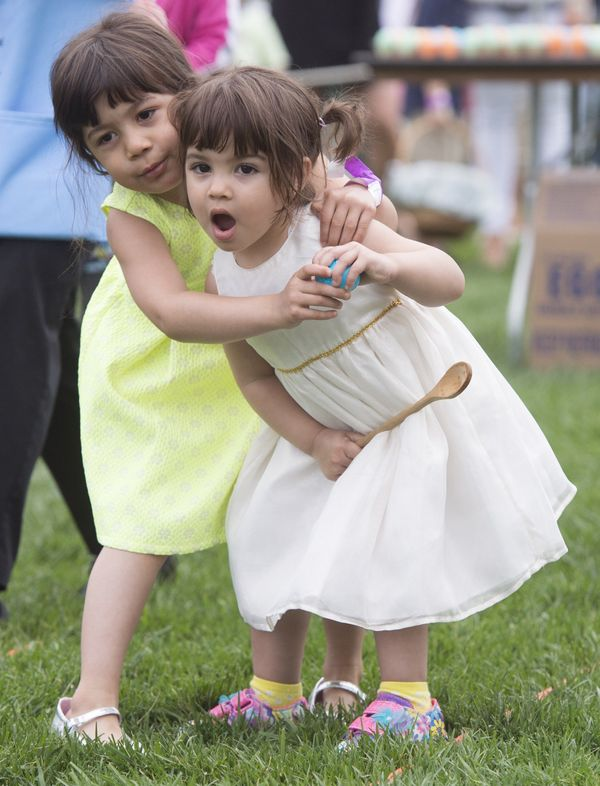 Children participate in an Easter egg roll race during the 139th White House Easter Egg Roll.
