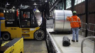 Workers load an aluminum coil onto a loading dock at the Arconic Inc. manufacturing facility in Alcoa, Tennessee, U.S., on Tuesday, Jan. 24, 2017. Arconic Inc. is scheduled to release earnings figures on January 31. Photographer: Luke Sharrett/Bloomberg via Getty Images
