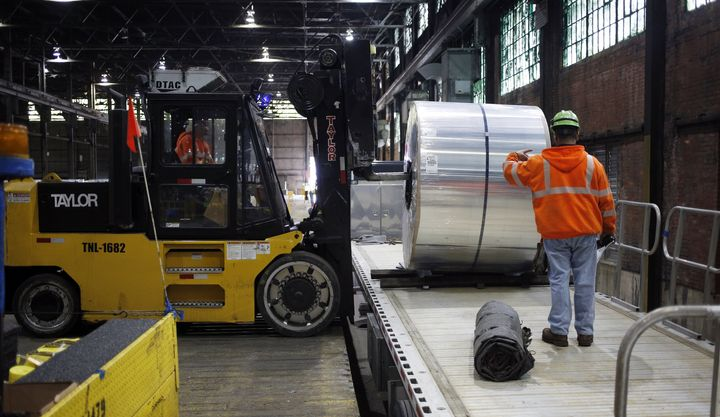 Workers load an aluminum coil onto a loading dock at the Arconic Inc. manufacturing facility in Alcoa, Tennessee, U.S., on Tu