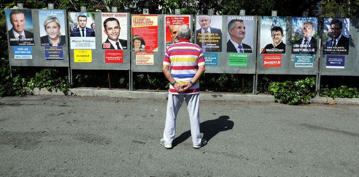Campaign posters of the 11 candidates in the French election. Left, right and centre can seem pretty blurred in 2017 France.