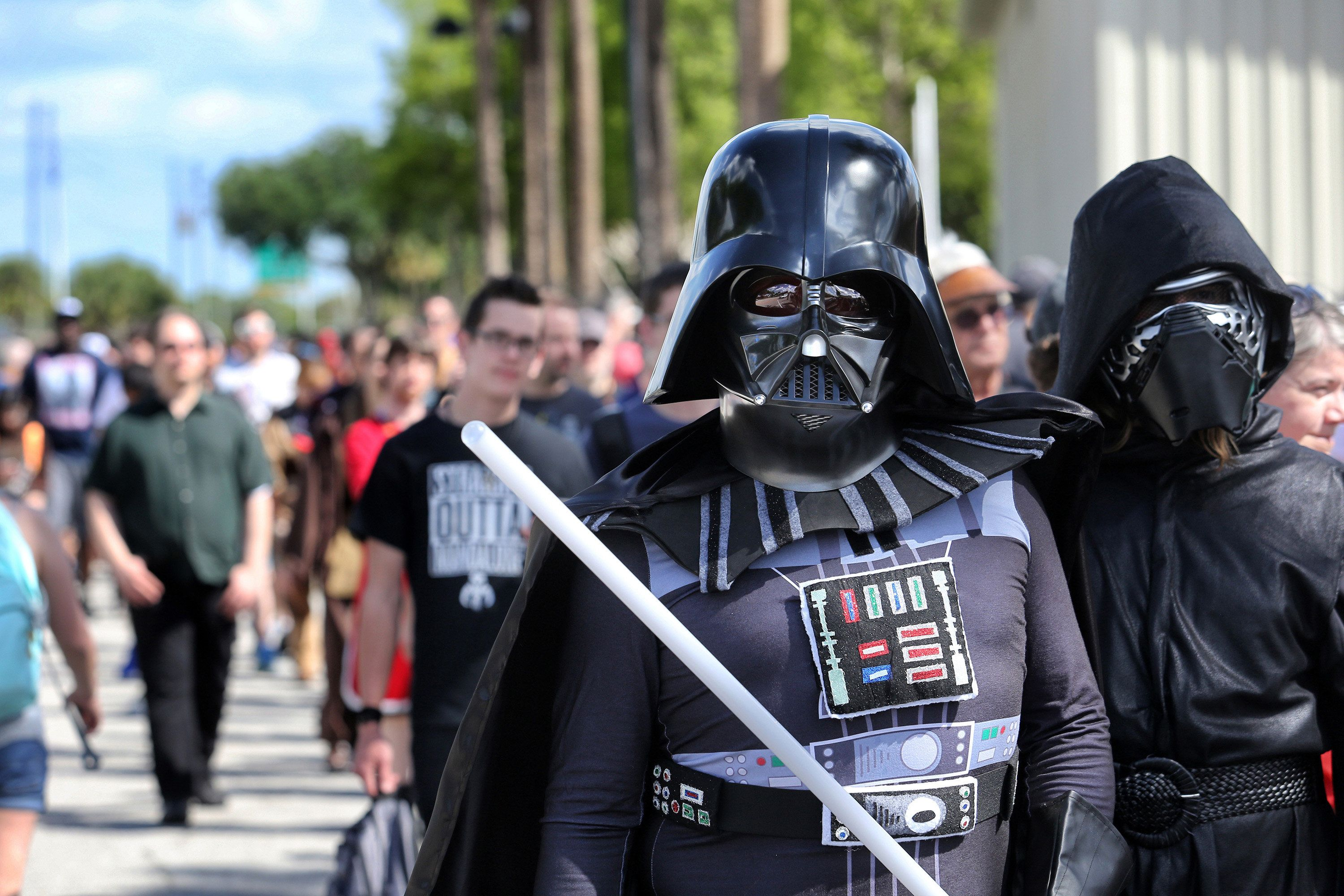 Costumed fans of the Star Wars franchise wait in a massive line outside the Orange County Center Thursday, April 13, 2017 in Orlando, Fla., to attend the 2017 Star Wars Celebration, marking the 40th anniversary of the original 1977 Star Wars film. Thousands of fans waited for hours in the line, estimated to be more than a mile long. (Joe Burbank/Orlando Sentinel/TNS via Getty Images)