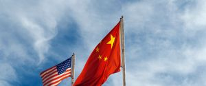 AMERICAN FLAG BANNER BONDING CHINA CHINESE FLAG COMPETITION FLAG FLYING POLE POWER SKY THE AMERICAS TOGETHERNESS USA SUPERPOWER