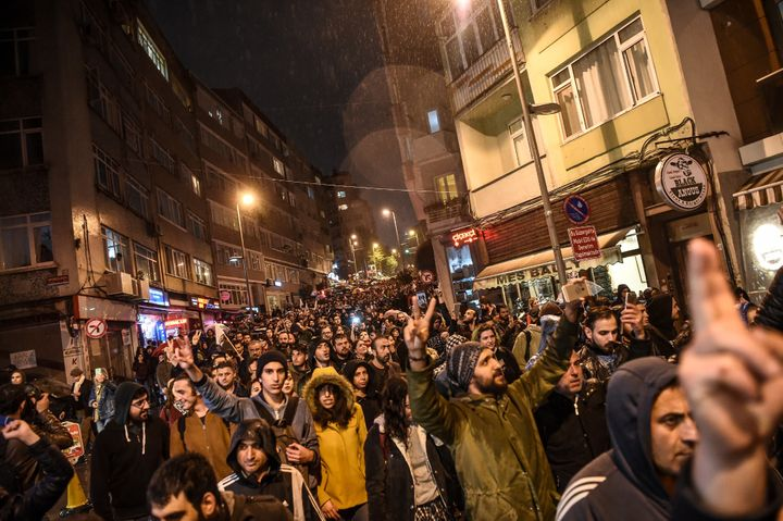 Supporters of the 'No' gesture and shout as they gather at the Besiktas district in Istanbul on April 17, 2017 to protest fol