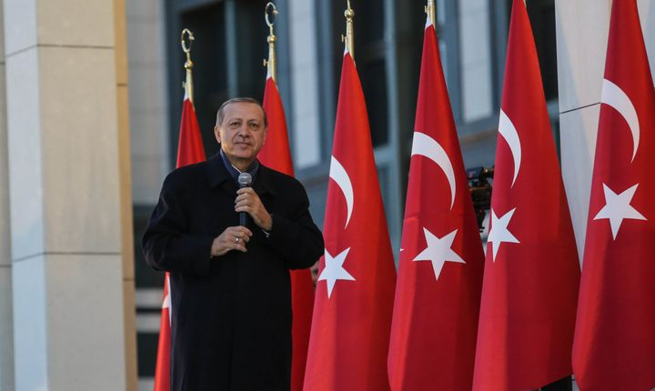 Turkish President Tayyip Erdogan gives a referendum victory speech to his supporters at the Presidential Palace on April 17,