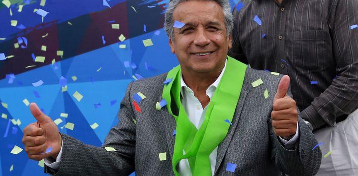 Lenin Moreno celebrates after Ecuador's election board said he won the country's presidential election.