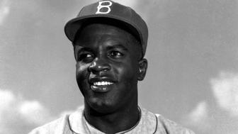 FILE PHOTO APR52 - Former professional baseball legend Jackie Robinson in April, 1952. The image is engraved in America's memory, the words written in America's soul. The famous pictures show all the joyous audacity he brought to baseball in the sport's most daring play.  SPORT BASEBALL
