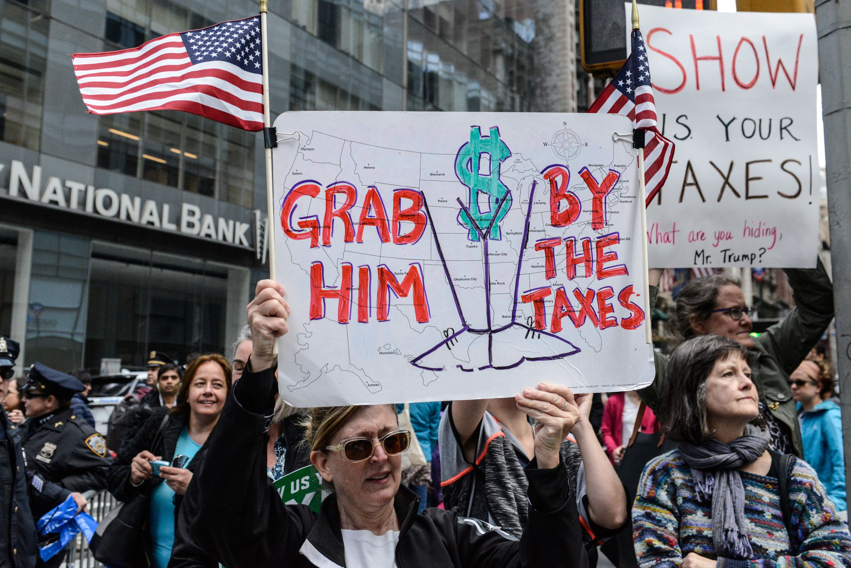NEW YORK, NY - APRIL 15: People participate in a Tax Day protest on April 15, 2017 in New York City. Activists in cities across the nation are marching today to call on President Donald Trump to release his tax returns. (Photo by Stephanie Keith/Getty Images)