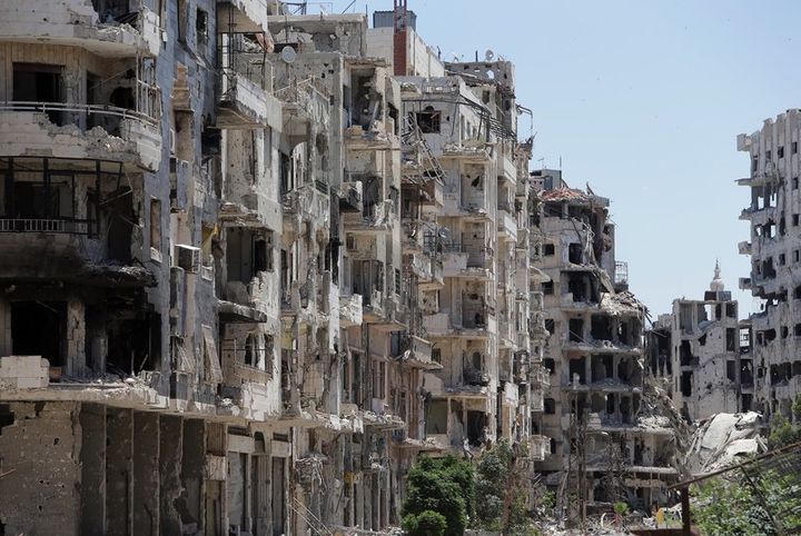 <p>Three years later, in 2014, an image shows destroyed buildings in the Homs neighborhood of Khaldiyeh, formerly held by rebel fighters and later captured by Syrian government forces faithful to Bashar al-Assad.</p>