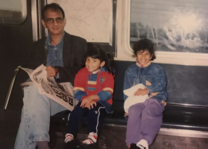 My father, sister, and I riding the New York subway.