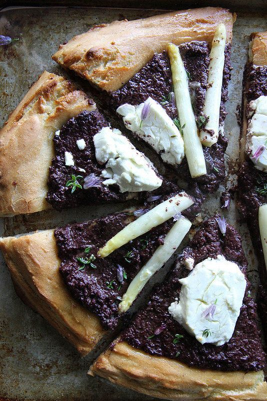 "<strong>Get the <a href=""http://heatherchristo.com/cooks/2014/05/29/black-olive-goat-cheese-and-white-asparagus-pizza/"" targe"