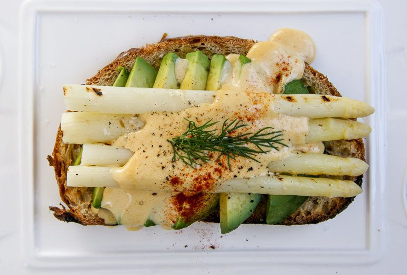 "<strong>Get the <a href=""http://iwillnoteatoysters.com/asparagus-toast-brown-butter-hollandaise/"" target=""_blank"">Asparagus T"