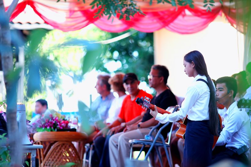 Students playing music during student award ceremony at the Caring for Cambodia (CFC) Aranh Sakor High School in Siem Reap