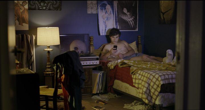 <p>Pyotr (played by <em>The Americans</em>, <em>Orphan Black</em>'s ALEX OZEROV) cruises on a gay dating app in Russia. </p>