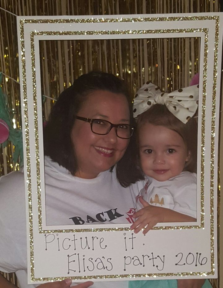 "The mom set up a photo area with a frame that said ""Picture it: Elisa's party 2016."""