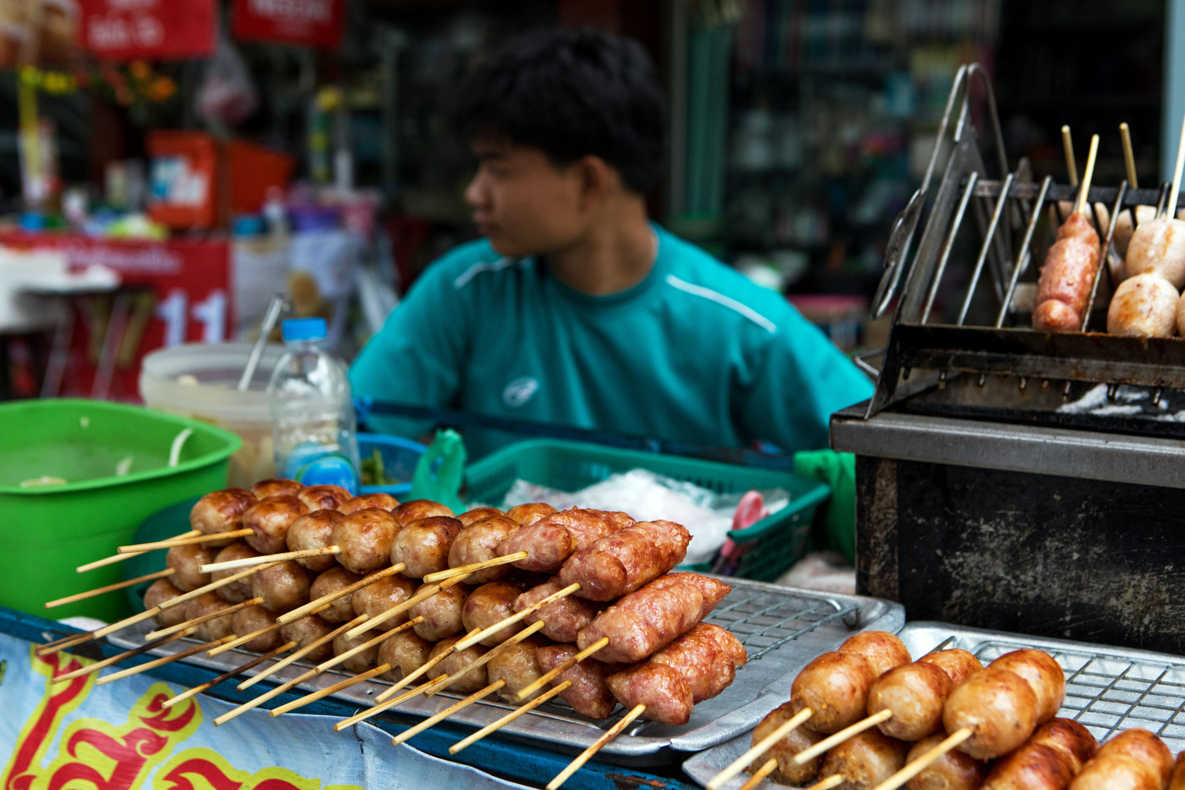 Grilled sausages and other meat snacks sit on display at a food stall in the Phaya Thai District of Bangkok, Thailand, on Wednesday, April 5, 2017. The central bank predicts growth will accelerate to 3.4 percent in 2017, which would be the highest in five years, that's still below Bank of Thailand Governor Veerathai Santiprabhob's estimate of potential growth of 4 percent to 4.5 percent. Photographer: Amanda Mustard/Bloomberg via Getty Images