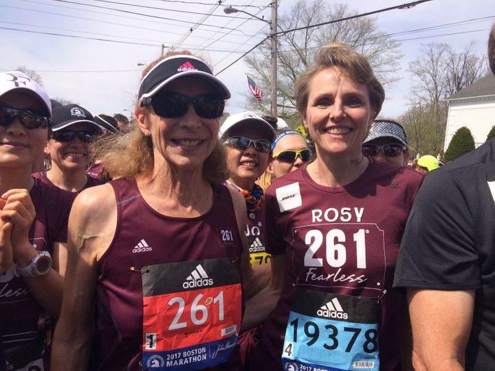 Switzer, left at Boston marathon starting line in Hopkinton, Mass, accompanied by Rosy Sprager, a 261 Fearless team member.