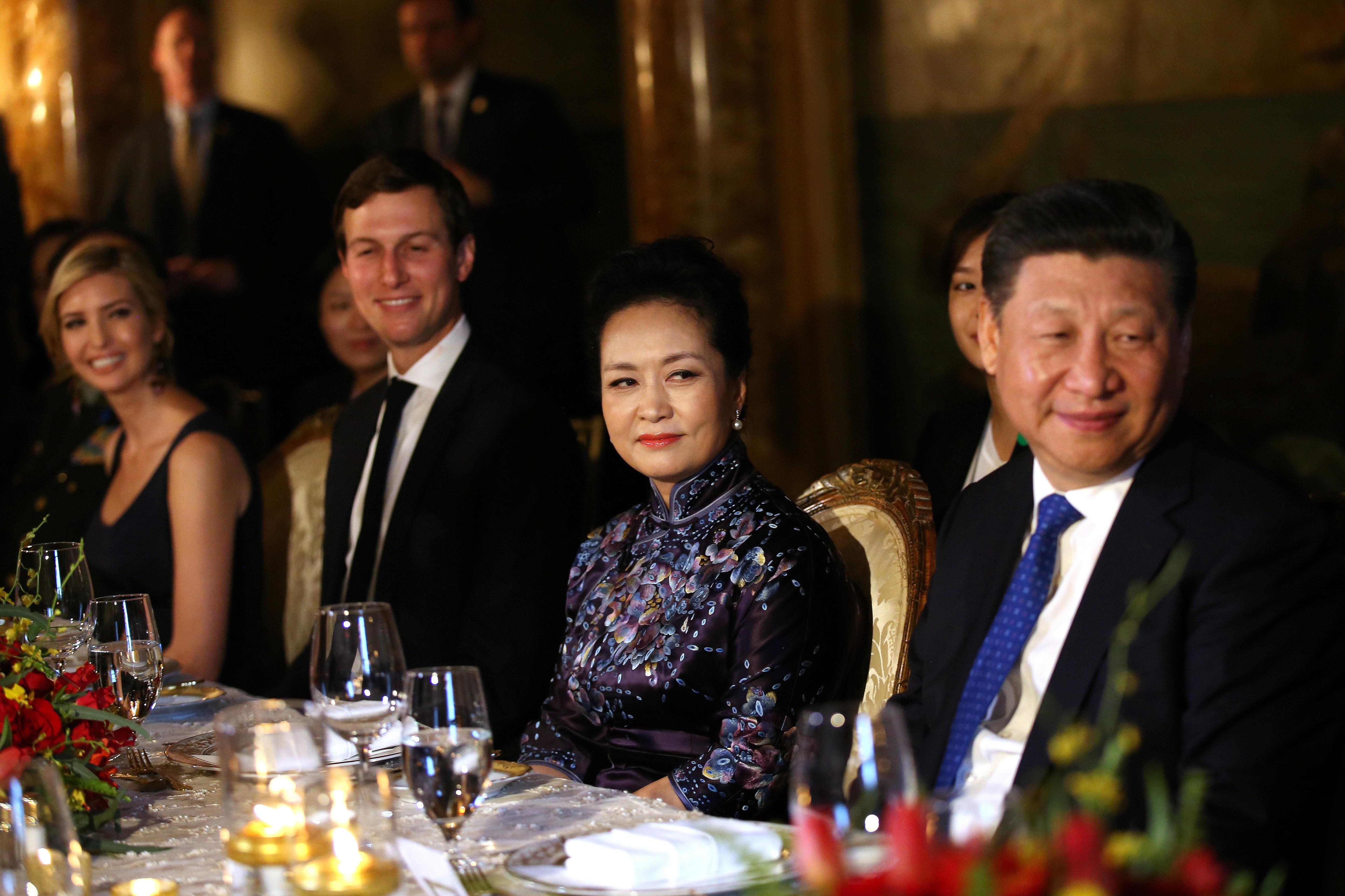 Chinese first lady Peng Liyuan and Chinese President Xi Jinping sit next to Jared Kushner and Ivanka Trump at Trump's Mar-a-L