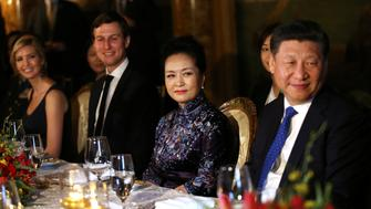 China's first lady Peng Liyuan looks at Chinese President Xi Jinping (R) as she sits next to Trump Senior Advisor Jared Kushner and Ivanka Trump (L), during a dinner at the start of a summit between U.S. President Donald Trump and Chinese President Xi at Trump's Mar-a-Lago estate in West Palm Beach, Florida, U.S. April 6, 2017. REUTERS/Carlos Barria
