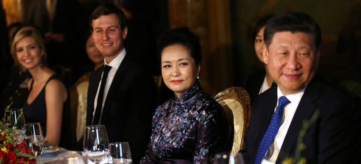 Chinese first lady Peng Liyuan and Chinese President Xi Jinping sit next to Jared Kushner and Ivanka Trump at Trump's Mar-a-L