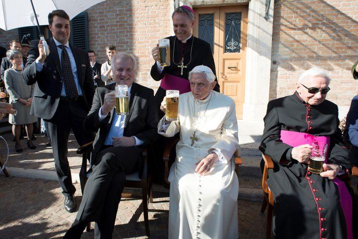Pope Emeritus Benedict XVIkicking it witha few close pals at the Vatican.
