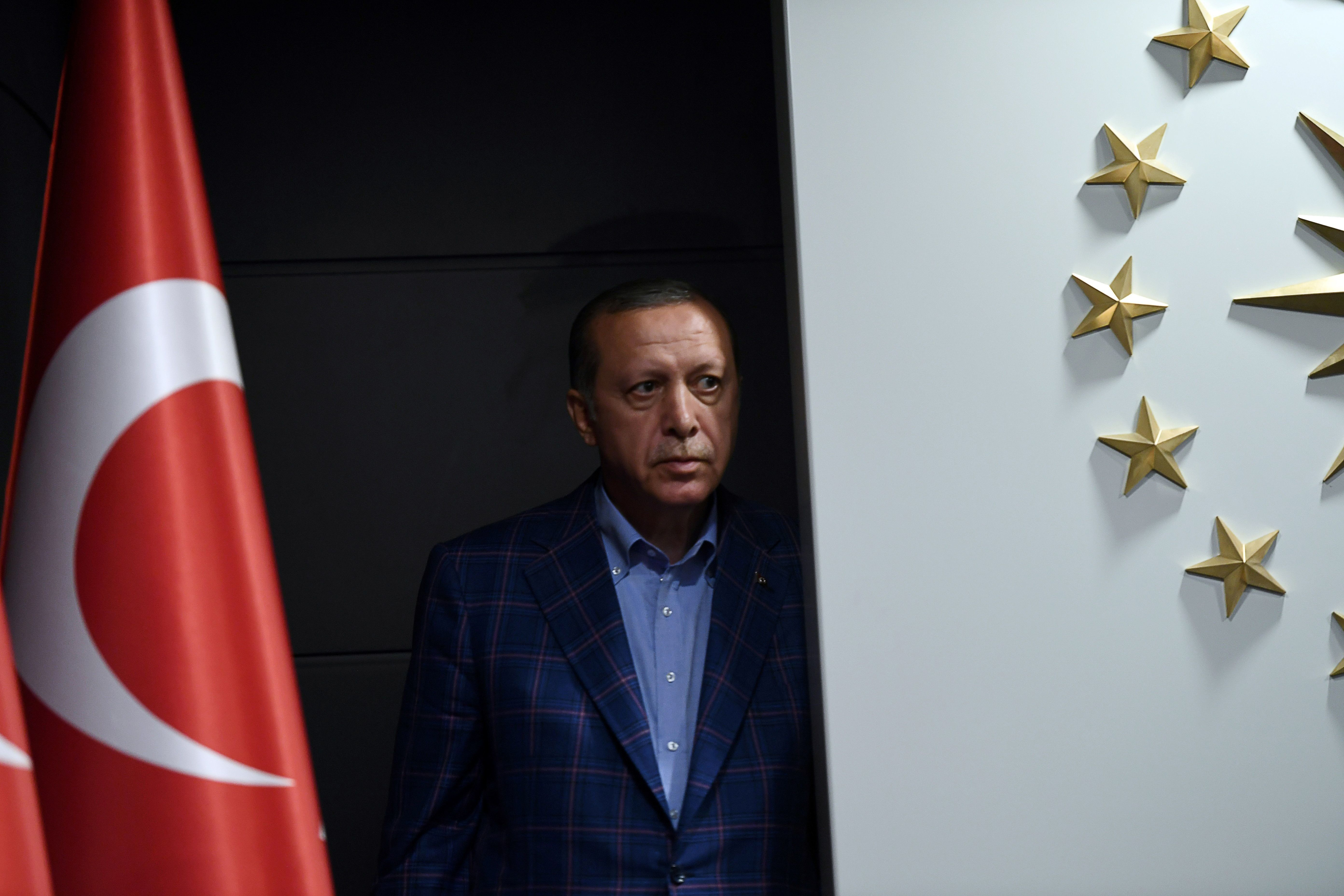Erdogan looks on before delivering a speech after the referendum results.Istanbul, April 16.