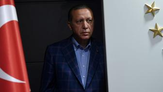 Turkish president Recep Tayyip Erdogan looks on as he arrives to deliver a speech at the conservative Justice and Development Party (AKP) headquarters in Istanbul, on April 16, 2017, after the results of a nationwide referendum that will determine Turkey's future destiny. Erdogan on April 16, 2017 hailed Turkey for making a 'historic decision' as he claimed victory in the referendum on a new constitution expanding his powers. The 'Yes' campaign to give Turkish President expanded powers won with 51.3 percent of the vote a tightly-contested referendum although the 'No' camp had closed the gap, according to initial results. But Turkey's two main opposition parties said they would challenge the results. / AFP PHOTO / Bulent Kilic        (Photo credit should read BULENT KILIC/AFP/Getty Images)