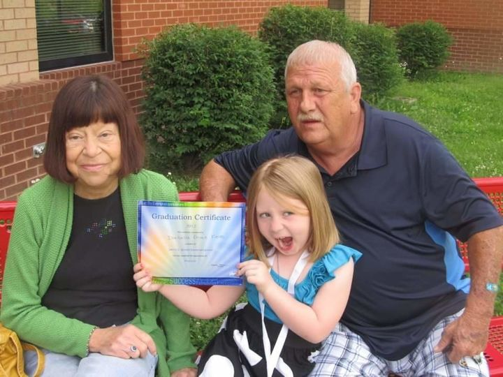 Kim and David Hoskin with one of their granddaughters.