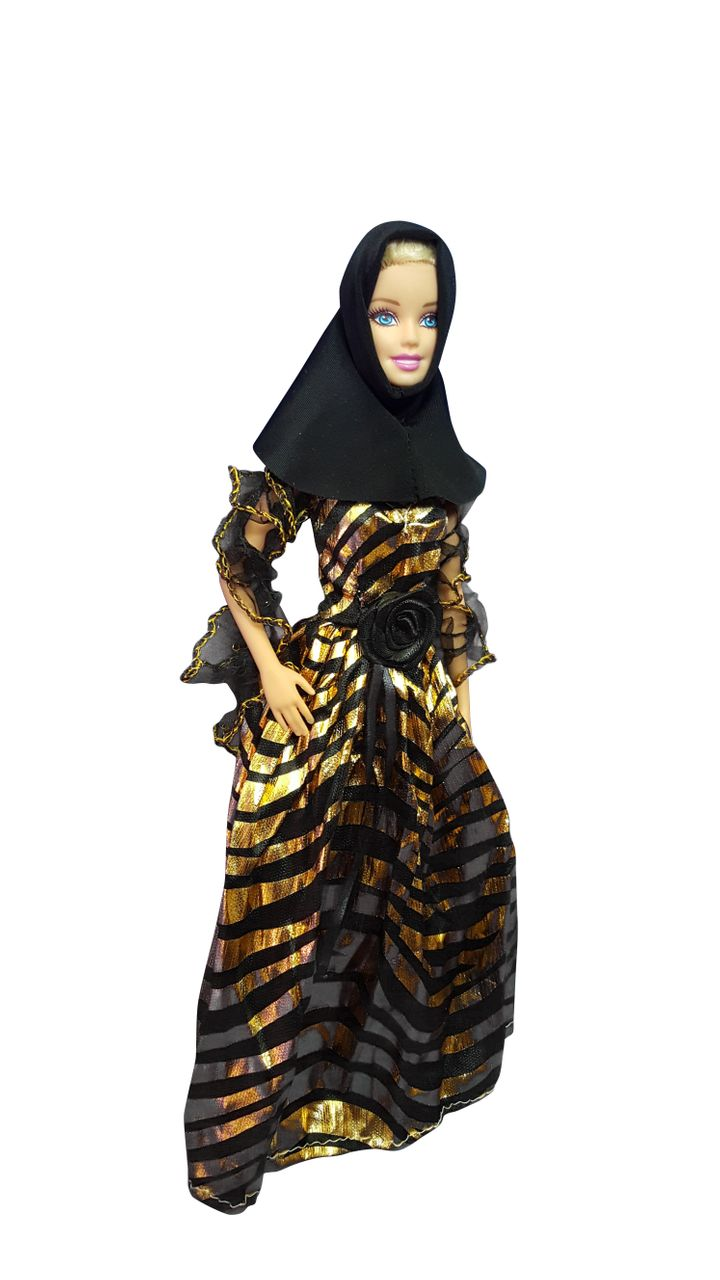 Shorso creates modest, Muslim-inspired fashions for Barbie dolls.