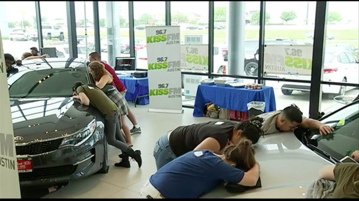 Nearly two dozen people entered a kissing competition in a bid to win a free Kia.