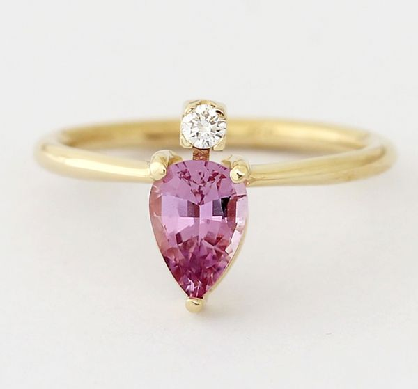 """<i>Buy it from <a href=""""https://www.artemerstudio.com/collections/all-rings/products/one-carat-pink-sapphire-ring"""" target=""""_b"""
