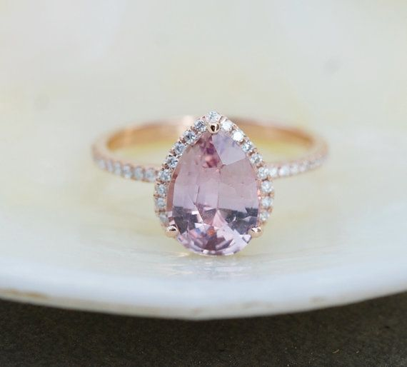 """<i>Buy it from <a href=""""https://www.etsy.com/listing/495884927/smokey-peach-sapphire-engagement-ring?ref=shop_home_active_45"""""""