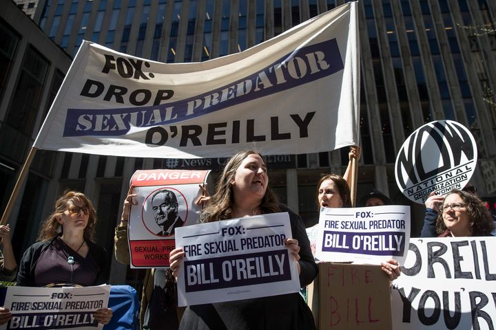 Demonstrators rally against Fox News television personality Bill O'Reilly outside of the News Corp. and Fox News headquarters