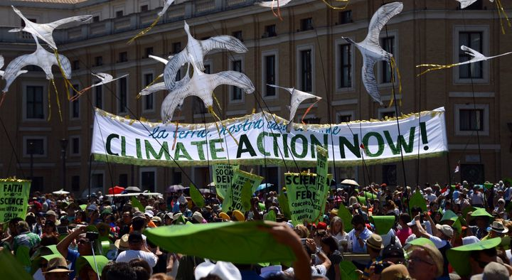 Environmental activists arrive on St. Peter's square prior to Pope Francis's Sunday Angelus prayer on June 28, 2015 at the Va