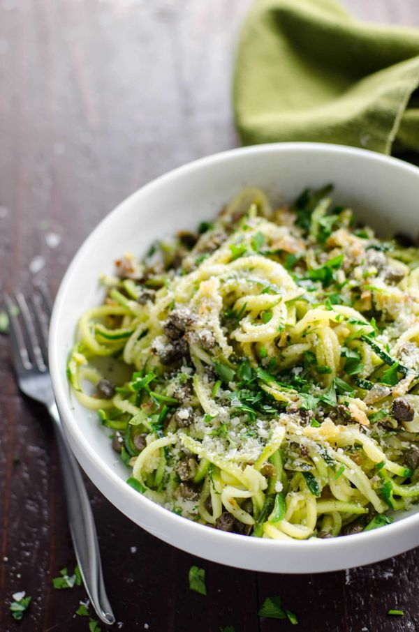 """<strong>Get the <a href=""""https://umamigirl.com/zucchini-noodles-zoodles-lemon-caper-butter"""" target=""""_blank"""">Zoodles with Lemo"""