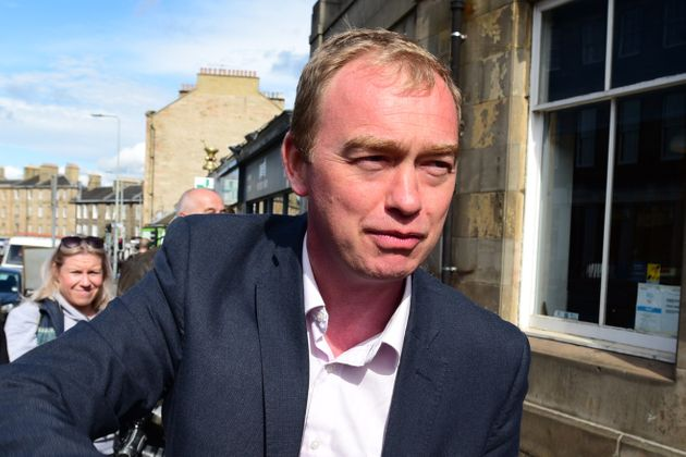 Tim Farron has said it is not 'tribalism' not to want to join a