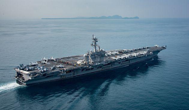U.S. aircraft carrier USS Carl Vinson travels throughthe Sunda