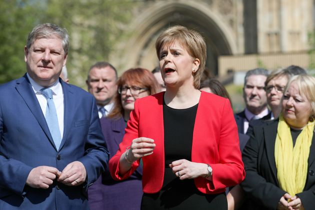 Sturgeon, with deputy leader of the Scottish National Party, Angus Robertson, outside the House of Parliament...