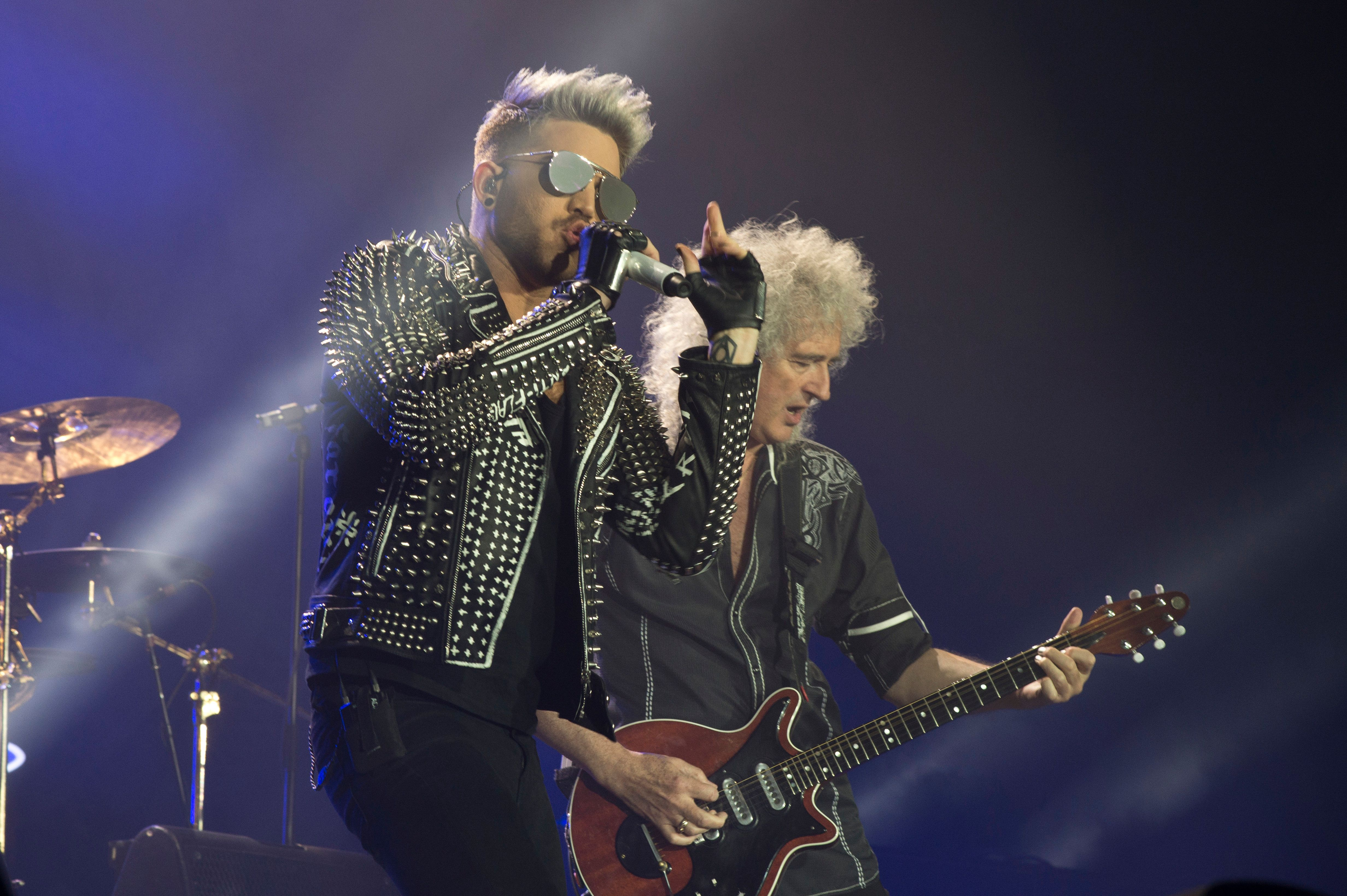 Brian May credits Adam Lambert's showmanship for keeping Queen's magic alive, 20 years after the loss...